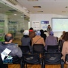 Ms. Guida Minkara, BIAT Project Coordination Officer, and the attendees during a presentation at the BIAT premises